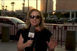 Woman wearing sunglasses holding a microphone