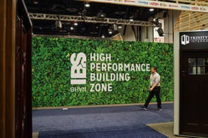 Man walking by High Performance Building Zone sign