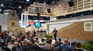 Audience watching a male presenter at the High performance building zone during 2019 builders' show