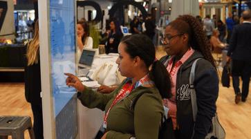 Two women looking at digital screen