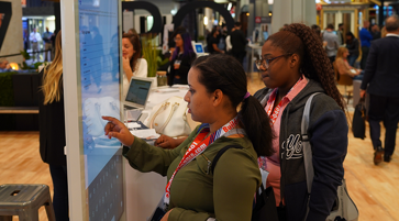 Woman interacting with a jumbo touch screen