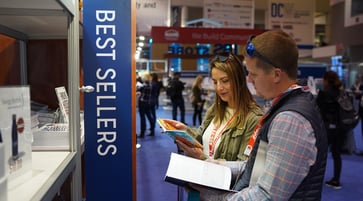 two people reading books at ibs store