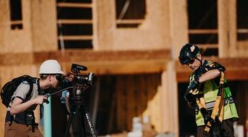 Cameraman filming man in safety gear