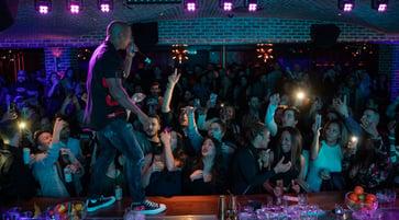 People dancing at a bar