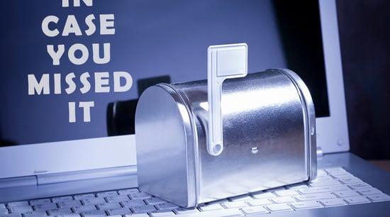 Mailbox sitting on top of laptop keyboard