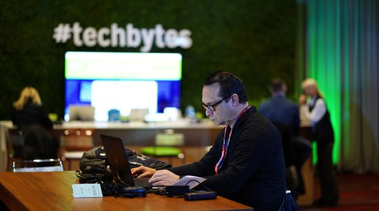 IBS 2019 attendee at work in the Tech Bytes room