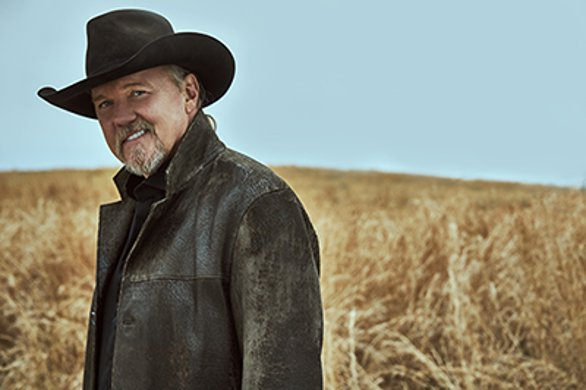 Country singer Trace Adkins, smiling standing in a field